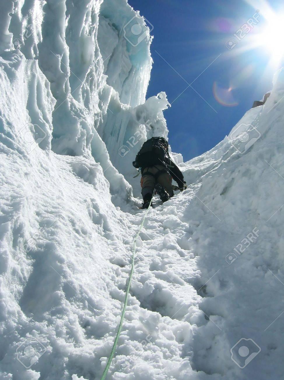 Climber the climb on glacier Stock Photo - 604024