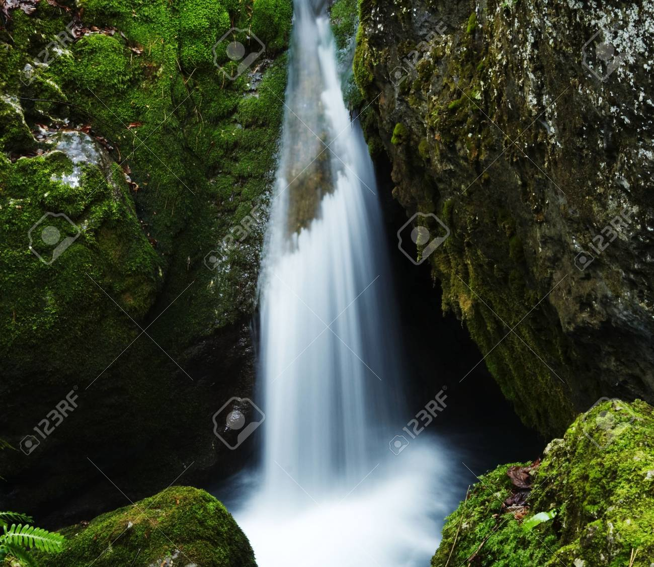 Waterfall movement on the stone background Stock Photo - 713366