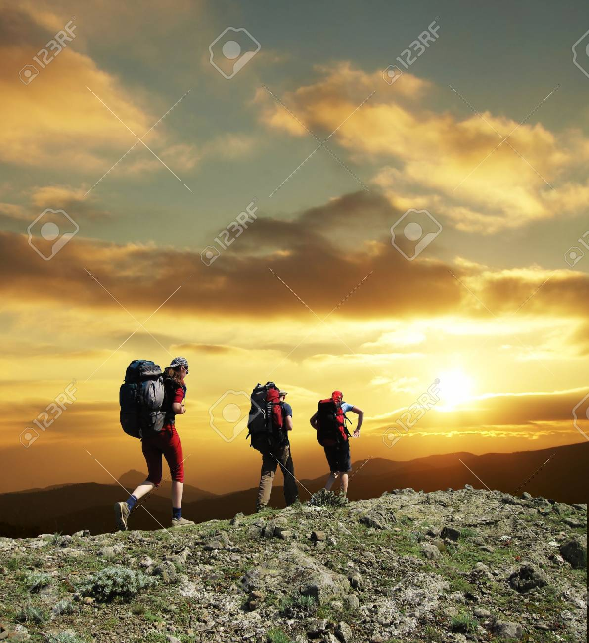 Group going along hill on sunset Stock Photo - 894787