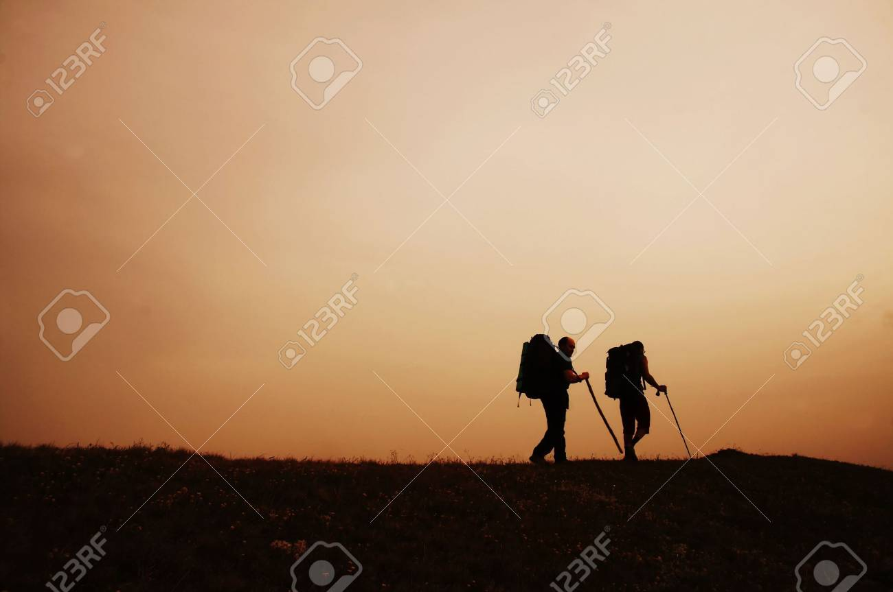 Couple going along hill on sunset Stock Photo - 1105242
