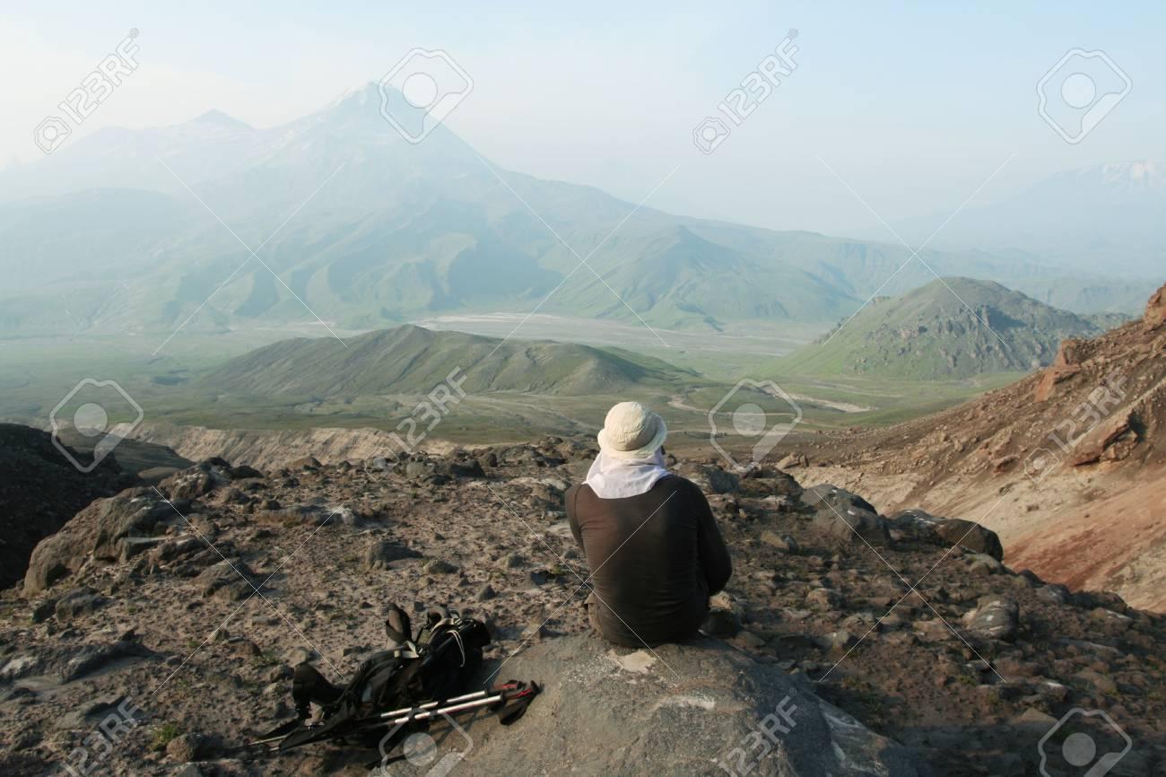 Man on the cliff in Kamchatka mountain Stock Photo - 1431090