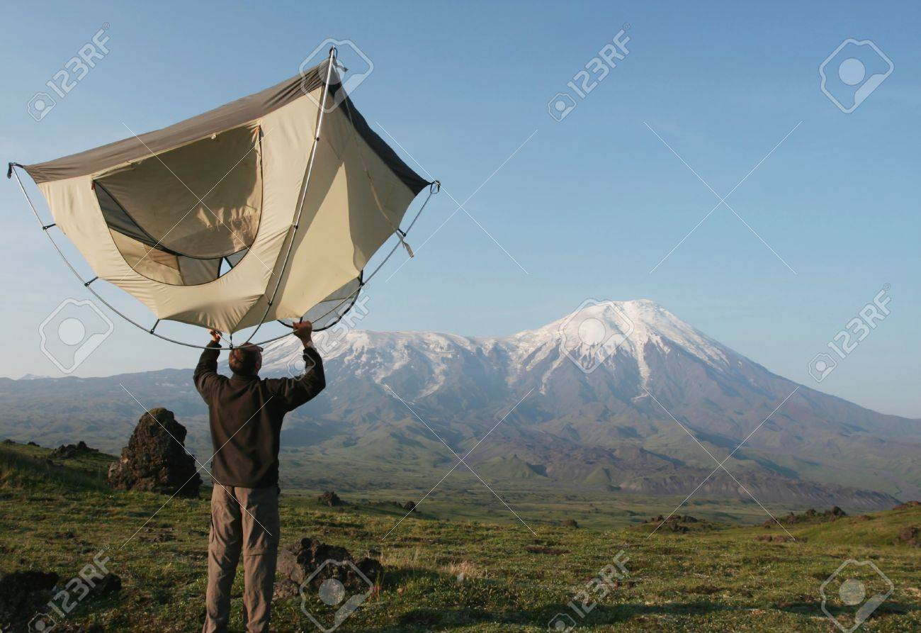 Man and tent in mountain on Kamchatka Stock Photo - 1423106