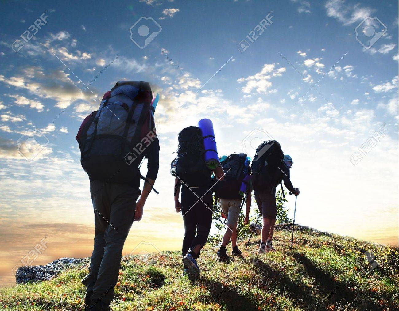 Hikers in  mountains Stock Photo - 3169318