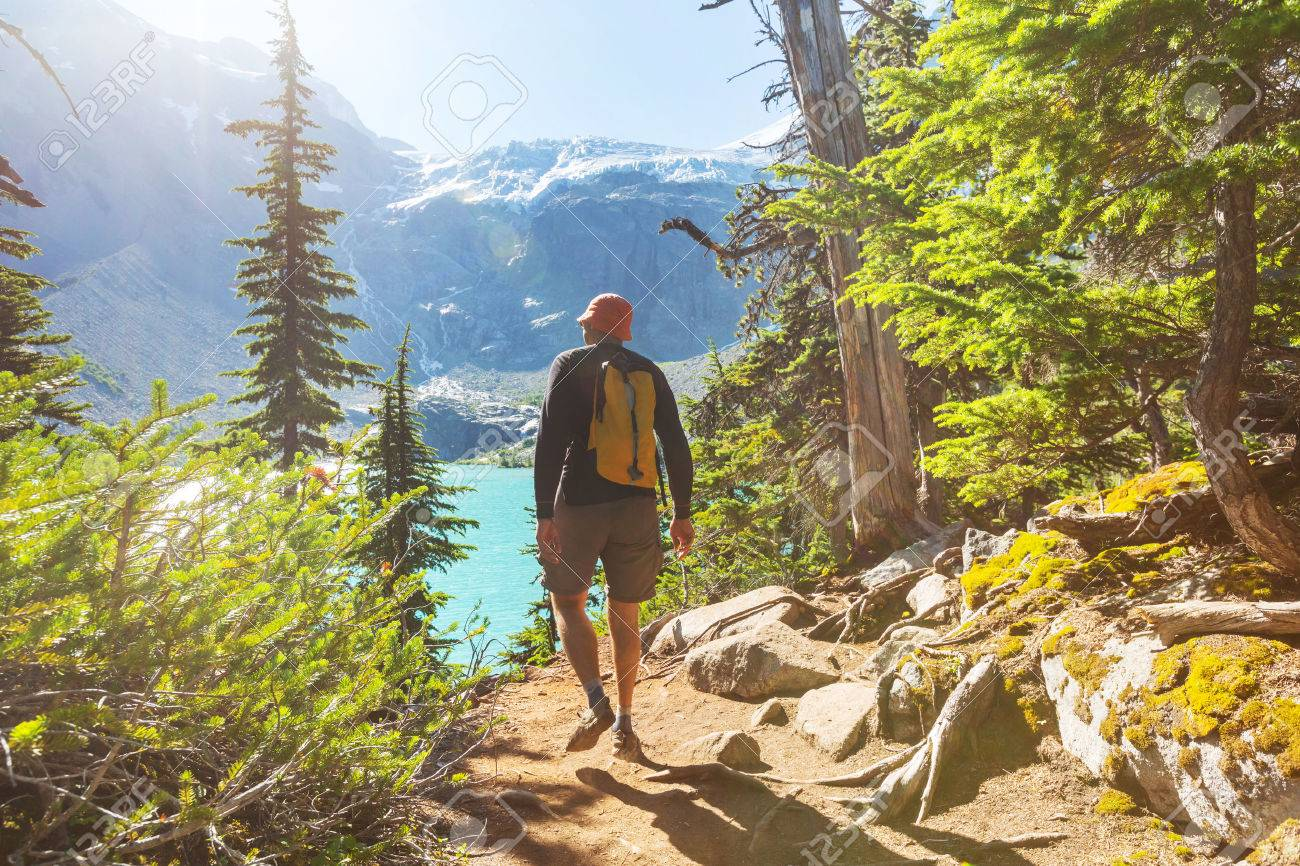 Hiking man in the mountains Stock Photo - 43989504
