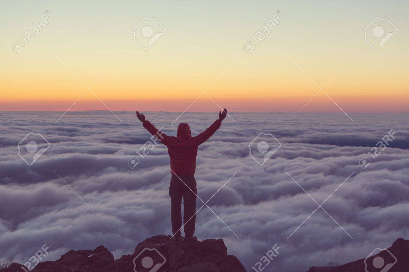 Beautiful sunset on the hill above clouds Stock Photo - 44717158