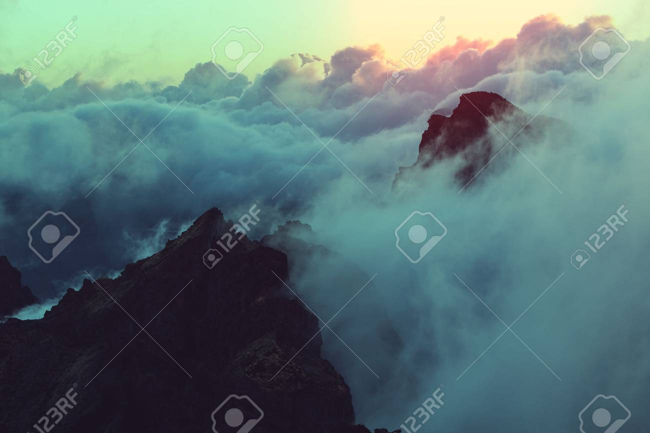 Beautiful sunset on the hill above clouds Stock Photo - 45483775