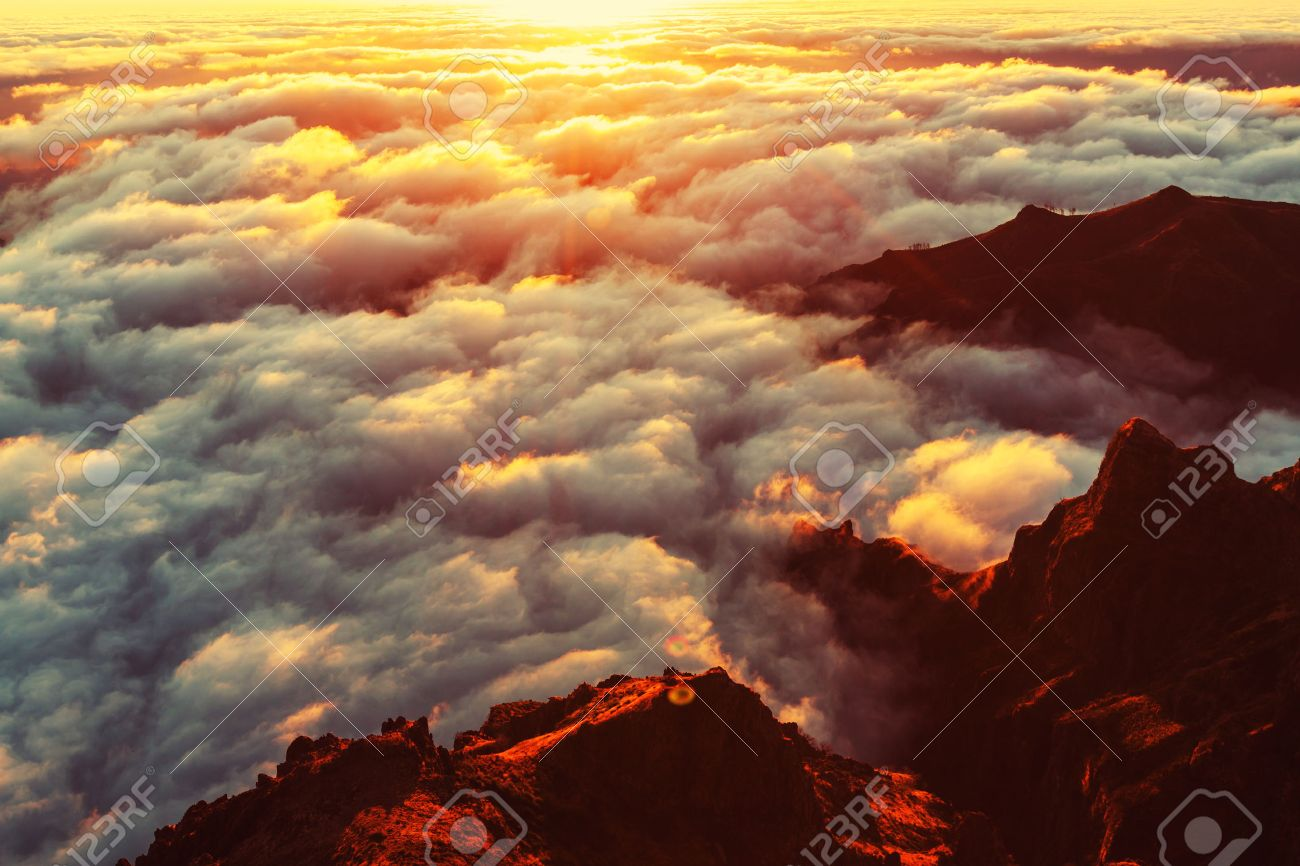 Beautiful sunset on the hill above clouds Stock Photo - 45486947