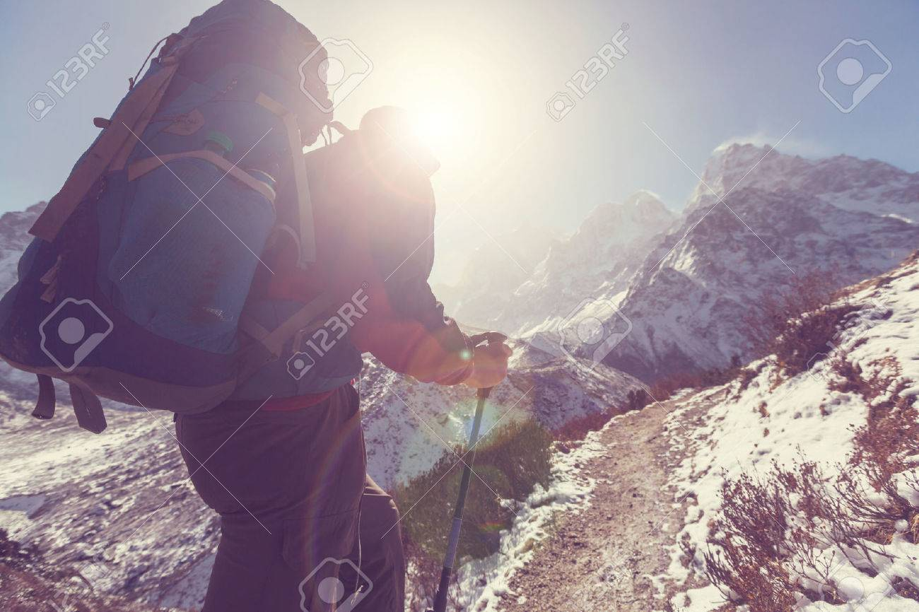 Hiker in Himalayas mountain. Nepal Stock Photo - 55444698