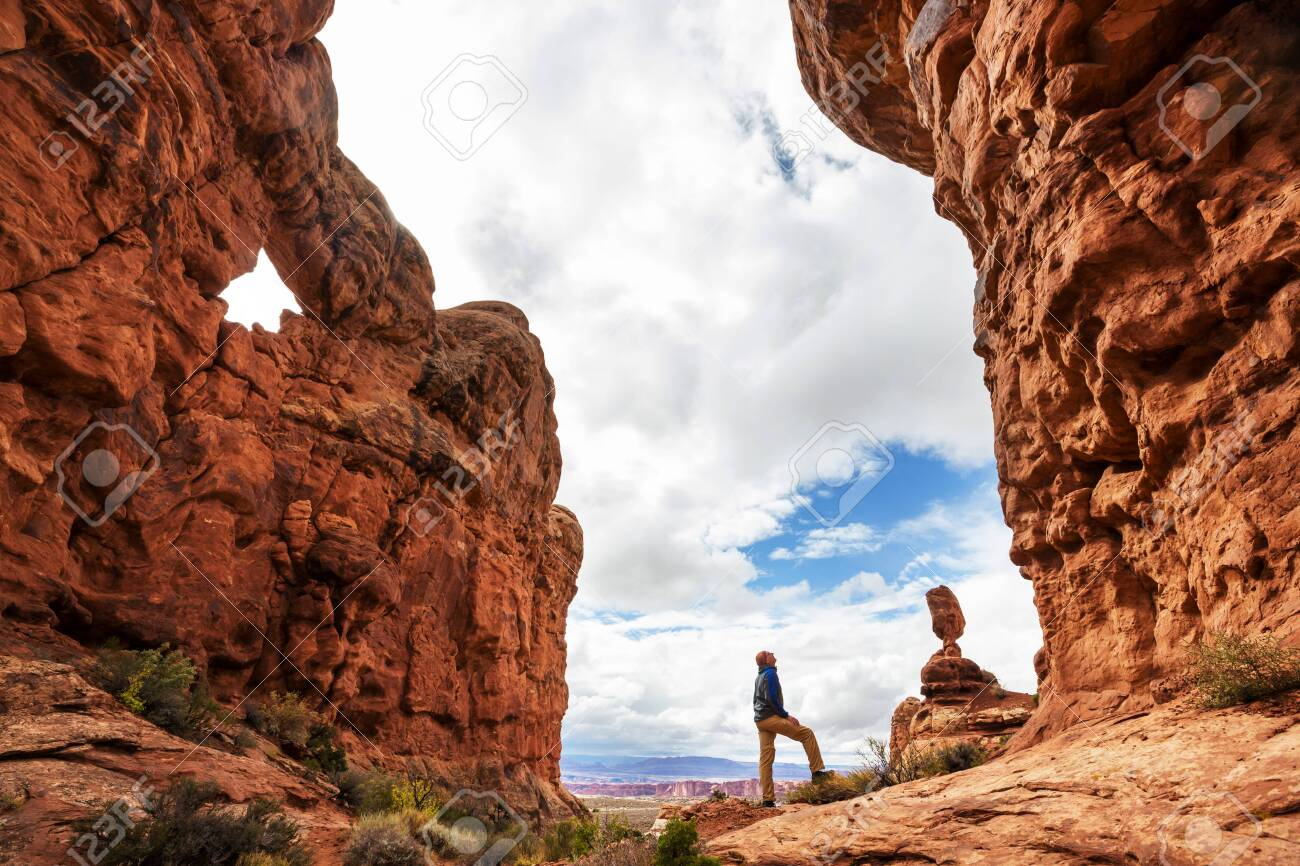 Hike in the Utah mountains. Hiking in unusual natural landscapes. Fantastic forms sandstone formations. - 128977366