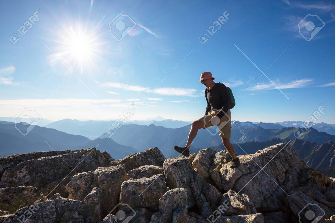 Backpacker in hike in the autumn mountains - 138706707