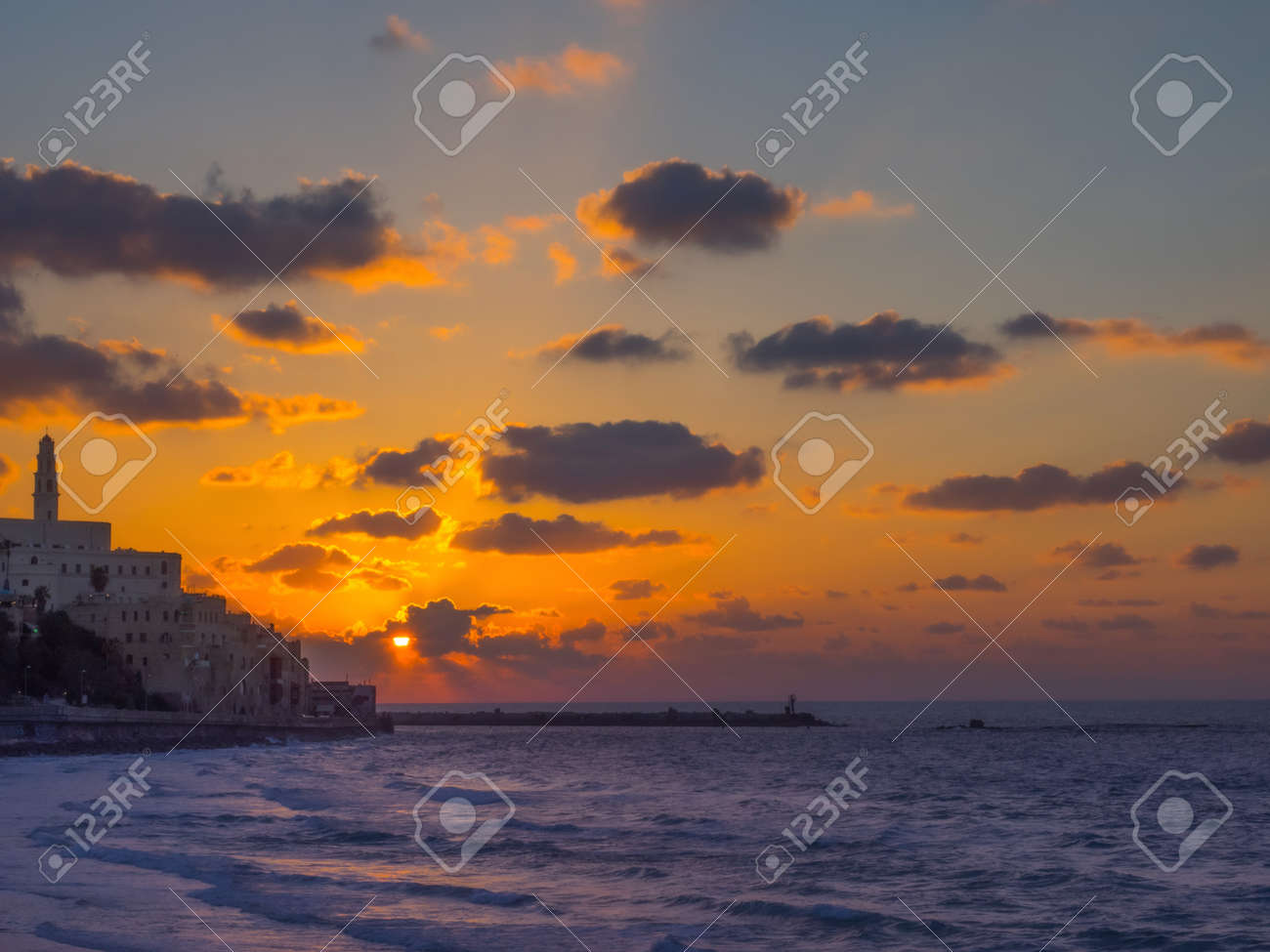 Coastal view of the ancient city of Yafo or Jaffanear Tel Aviv, Israel. Cityscape in sunset hour with clouds in the sky. - 170251309