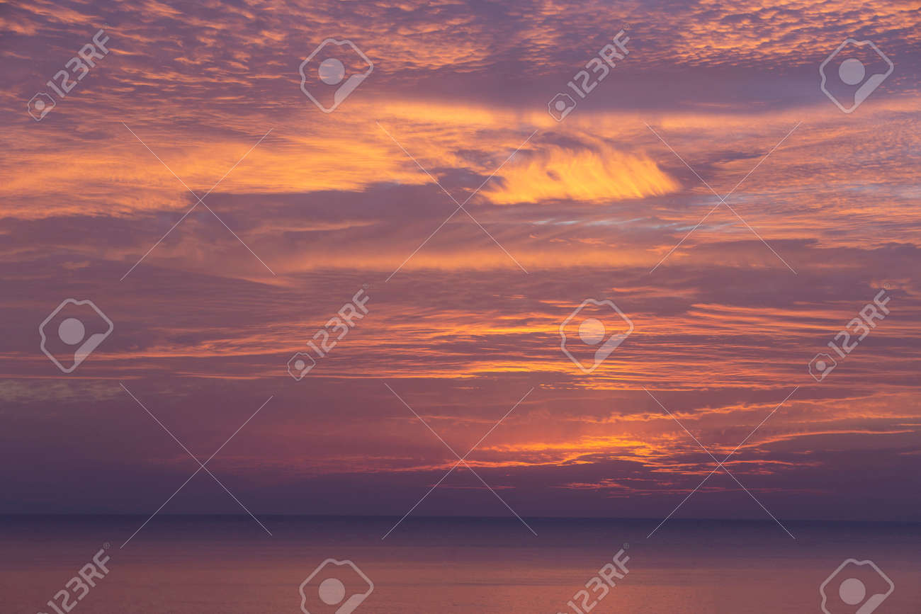 cirrus clouds at sunset over the sea - 170635108