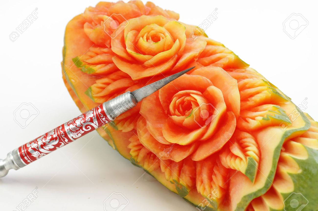 Carved papaya fruit and knife the art of Thailand - 13817455