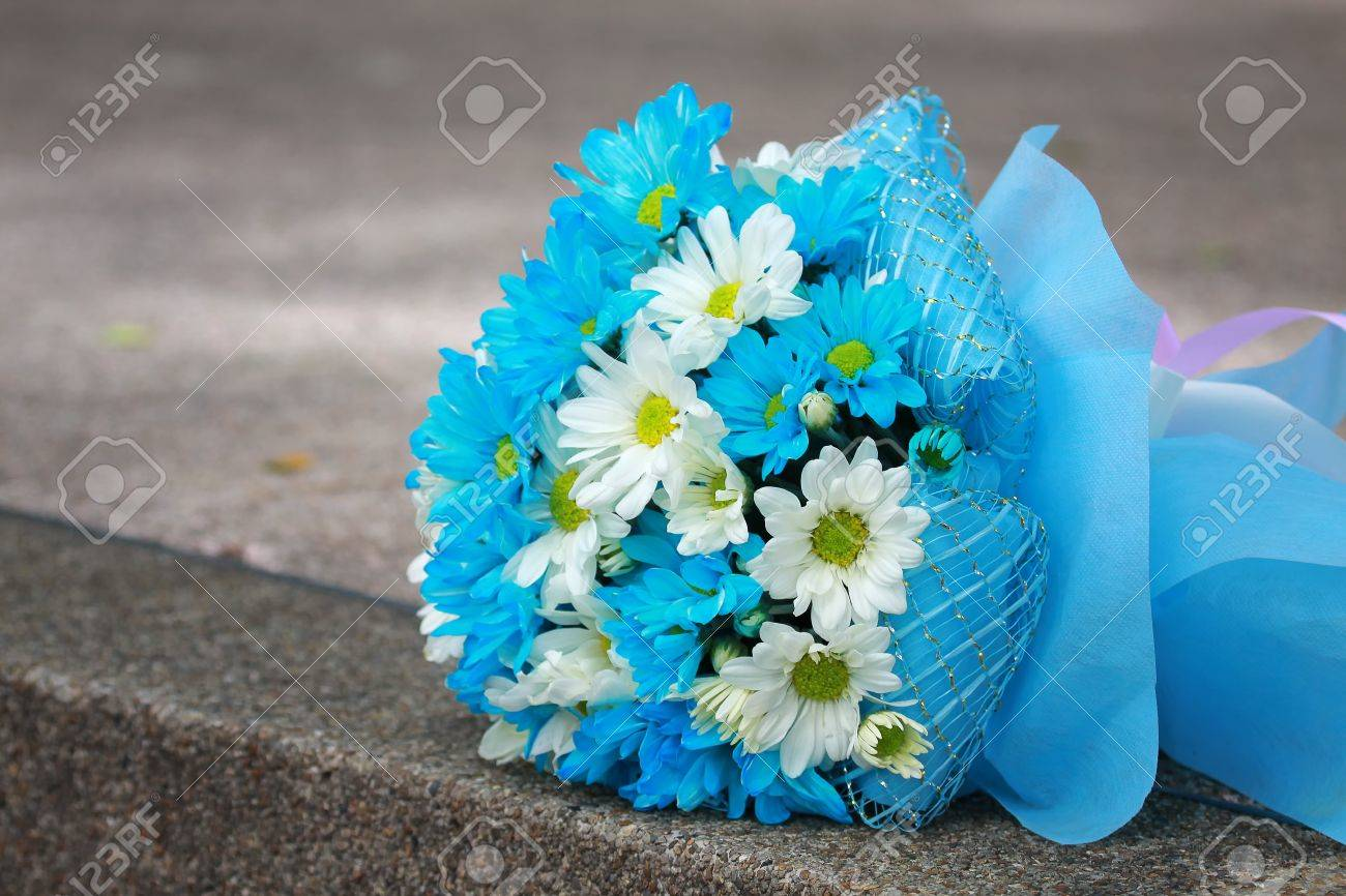 Beautiful bouquet of bright blue and white flowers on table beautiful bouquet of bright blue and white flowers on table on green background stock photo dhlflorist Image collections