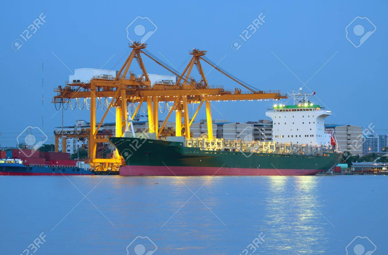 Container Cargo freight ship with working crane bridge in shipyard at dusk for Logistic Import Export background - 15404436