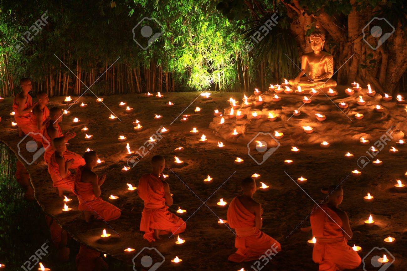 CHIANG MAI, THAILAND - November 28: Loy Kratong Festival, Buddhist monk fire candles to the Buddha on Nov 28, 2012 in Phan Tao Temple, Chiangmai, Thailand. - 16769023