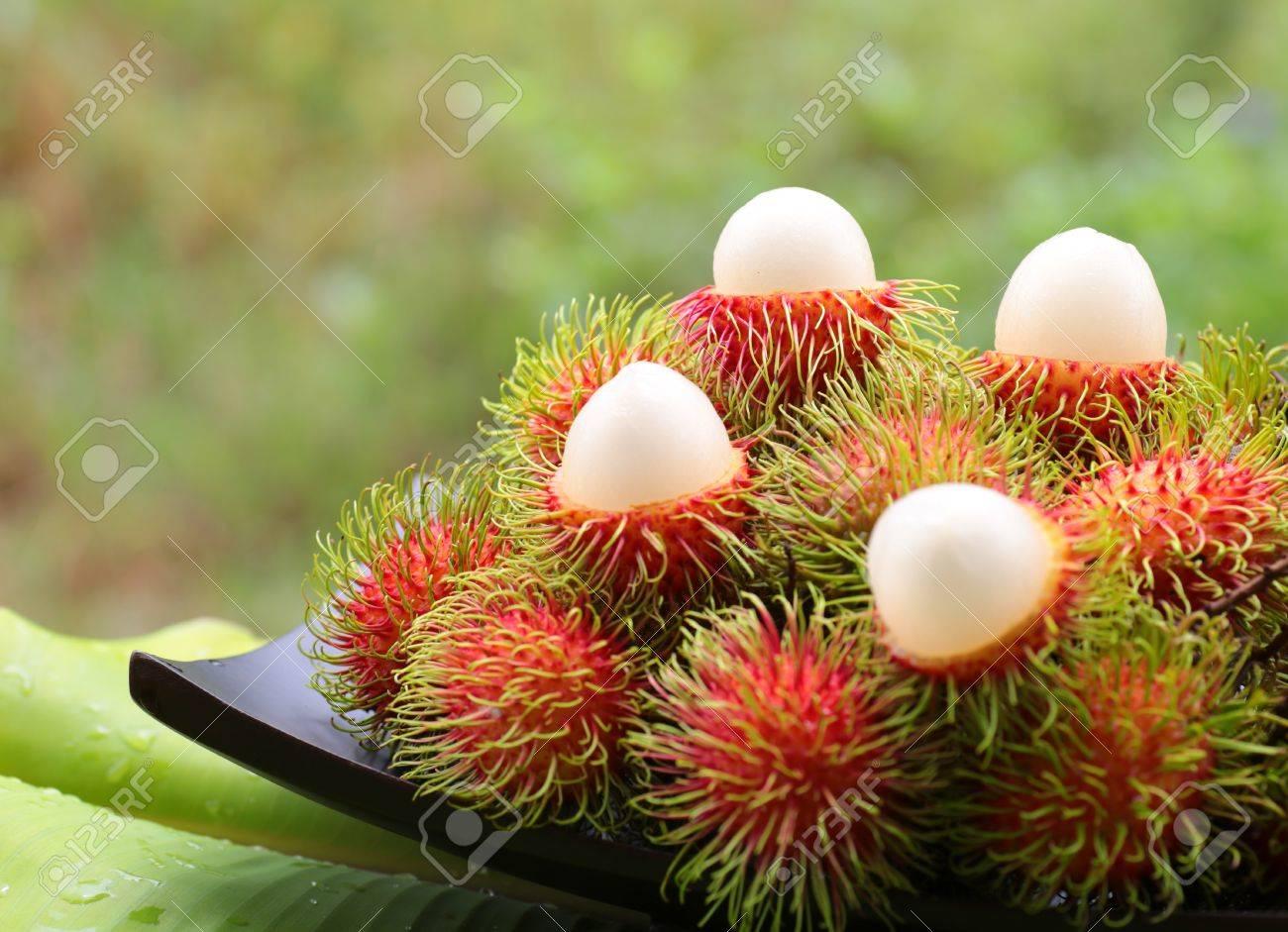 asian fruit rambutan on wooden tray - 19788370