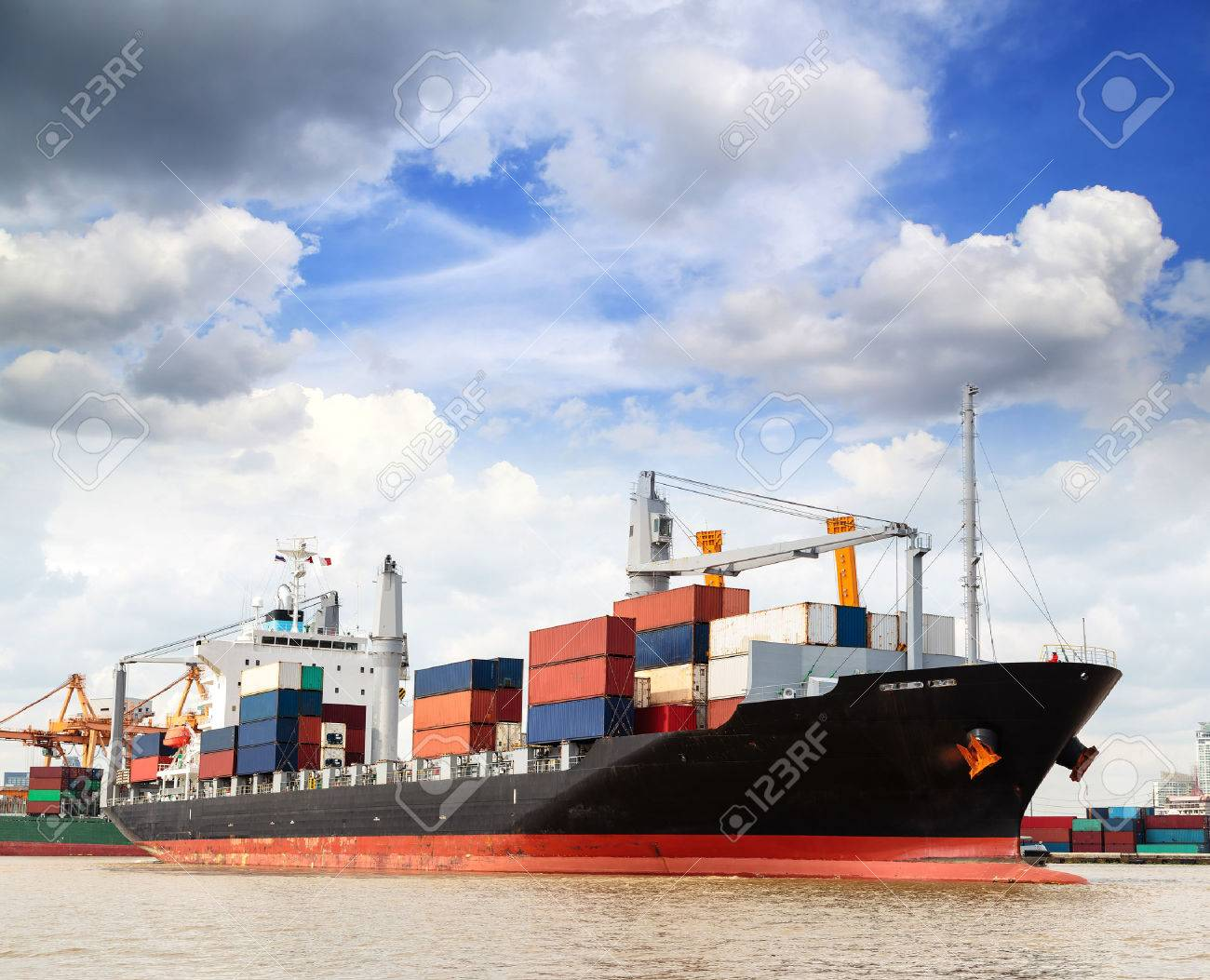 Cargo ship at the port outgoing with blue sky - 22874015