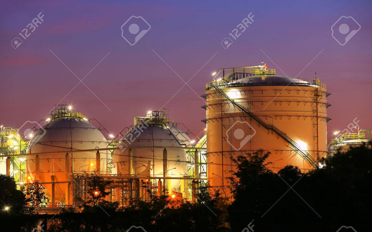 Chemical industrial storage sphere tanks at twilight time - 24411611