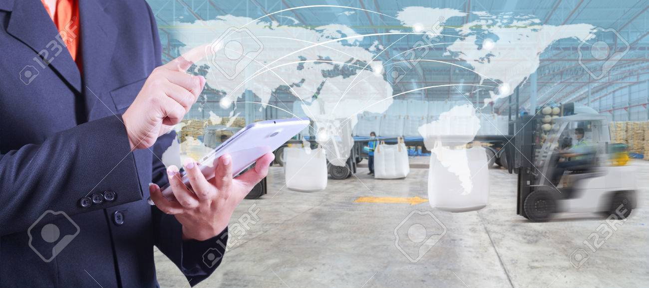 hand presses on world map with digital tablet,warehouse worker loading goods by forklift for Logistic Import Export background - 61090499