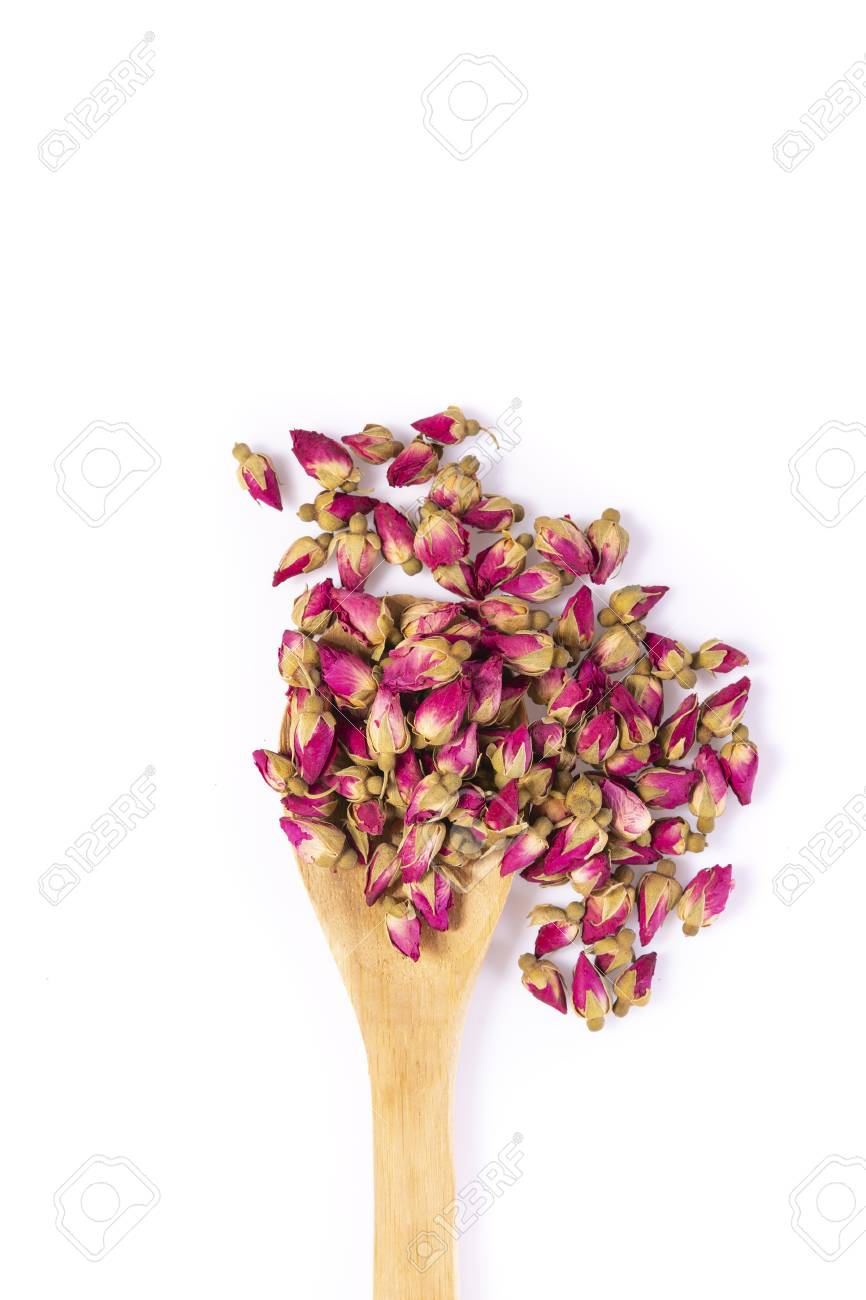 Flower tea rose buds with wooden spoon isolated on white background - flowers and plants. - 115189463