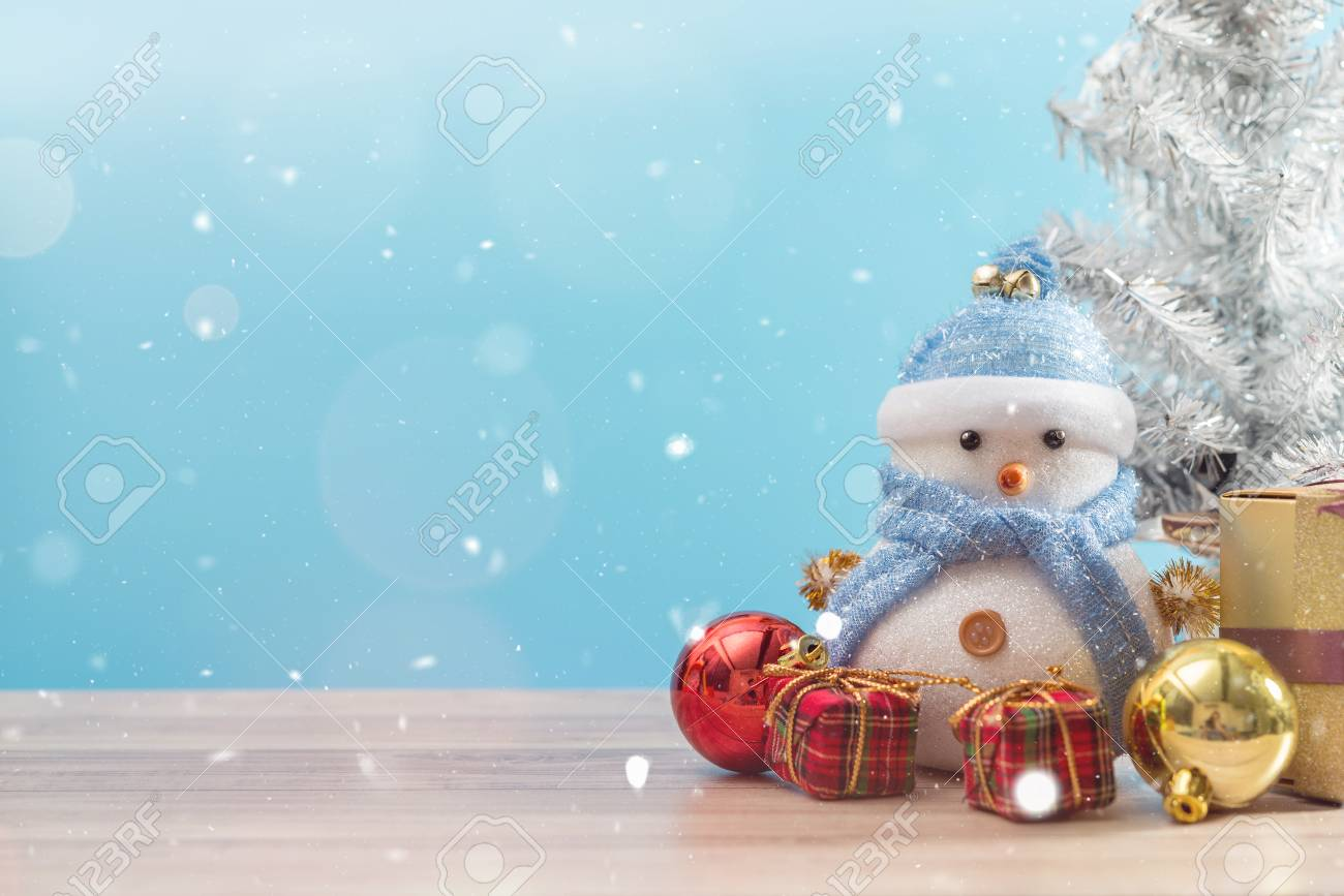 Christmas Snow.Happy Snowman Standing In Blue Winter Christmas Snow Background