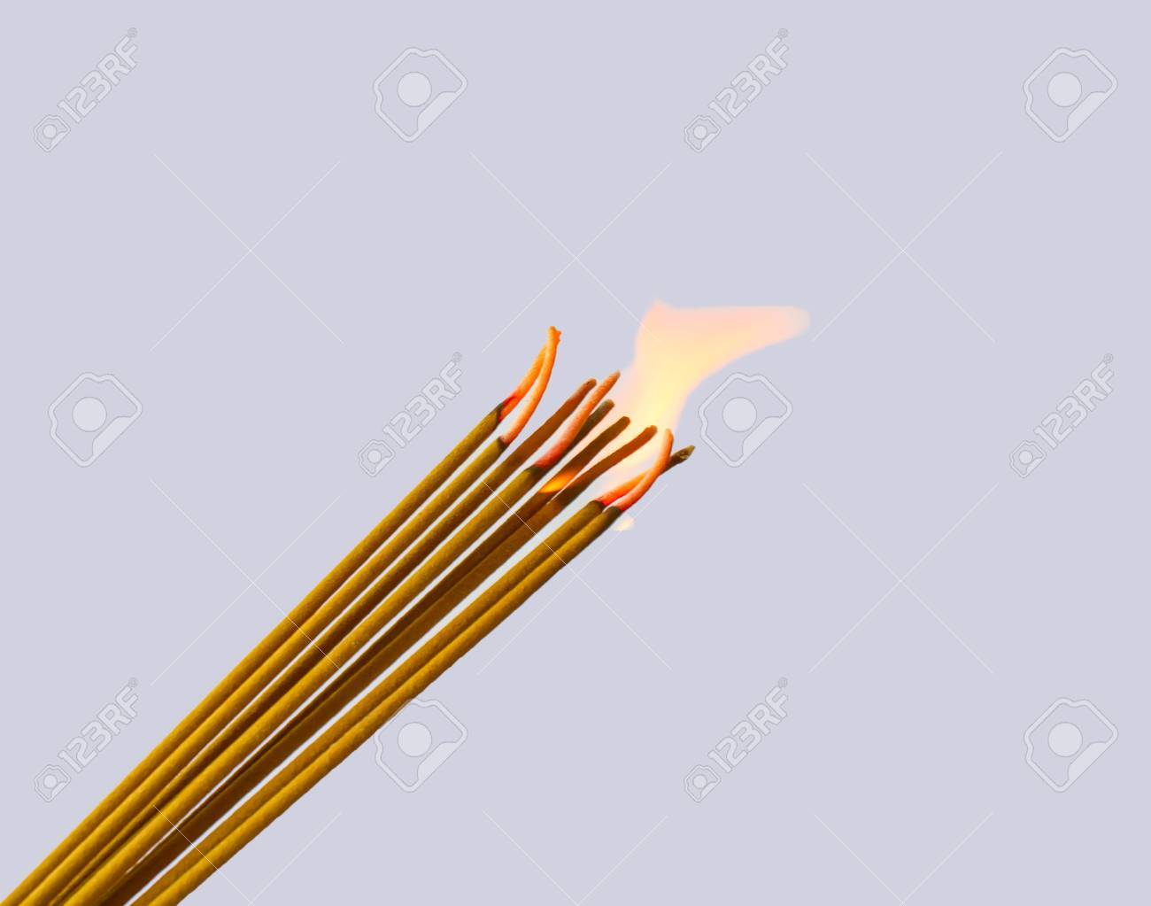 Photo of a burning incense stick with smoke on a grey background Stock Photo - 23116681