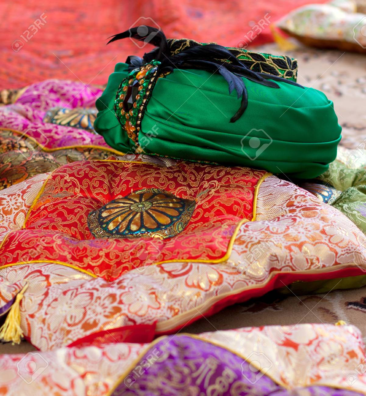 East  the lush green turban and decorative pillows Stock Photo - 15520490