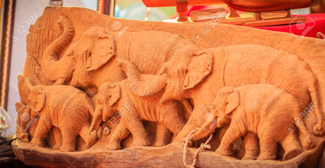 Beautiful wood carving of elephant family. antique art handmade