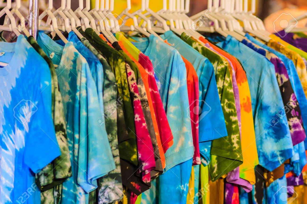 426292cc Beautiful Tie dye shirts and fabric for sale in night market at Bangkok,  Thailand Stock