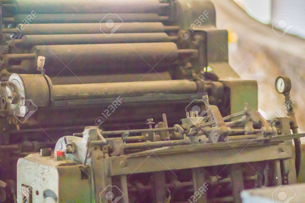An old printing press machine with rotary equipments  Close up