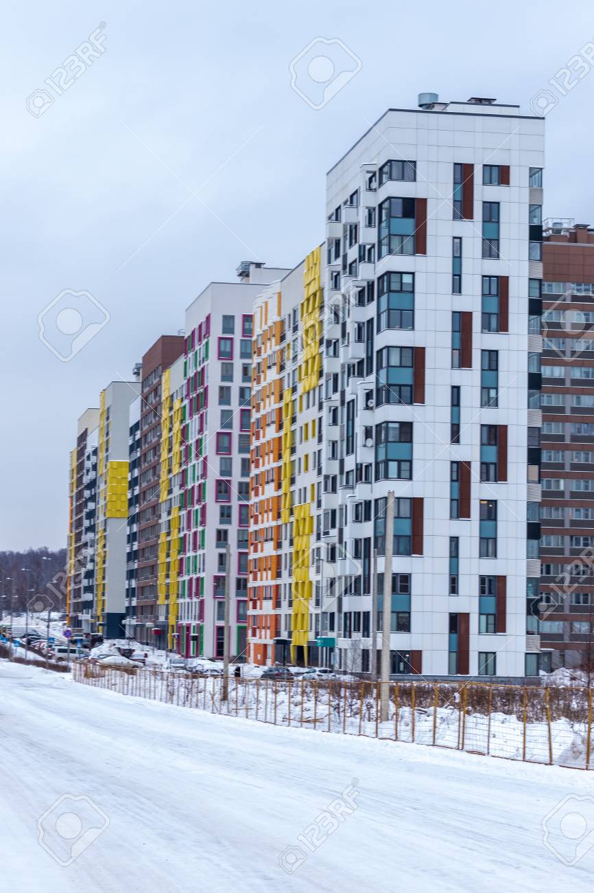 Modern apartment building with colorful facades on the outskirts..