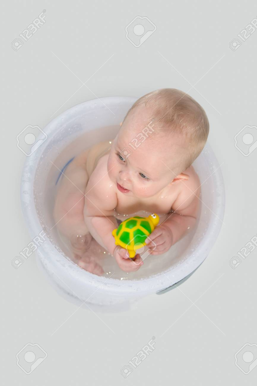 Little Girl Having A Bath In The Transparent Bathing Bucket And ...