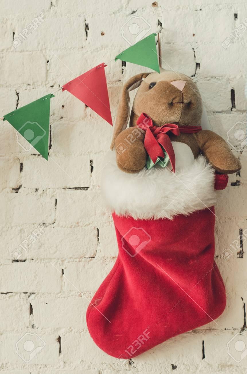 Bear Christmas Stocking.Christmas Stocking Filled With Teddy Bear Plush Toy On White