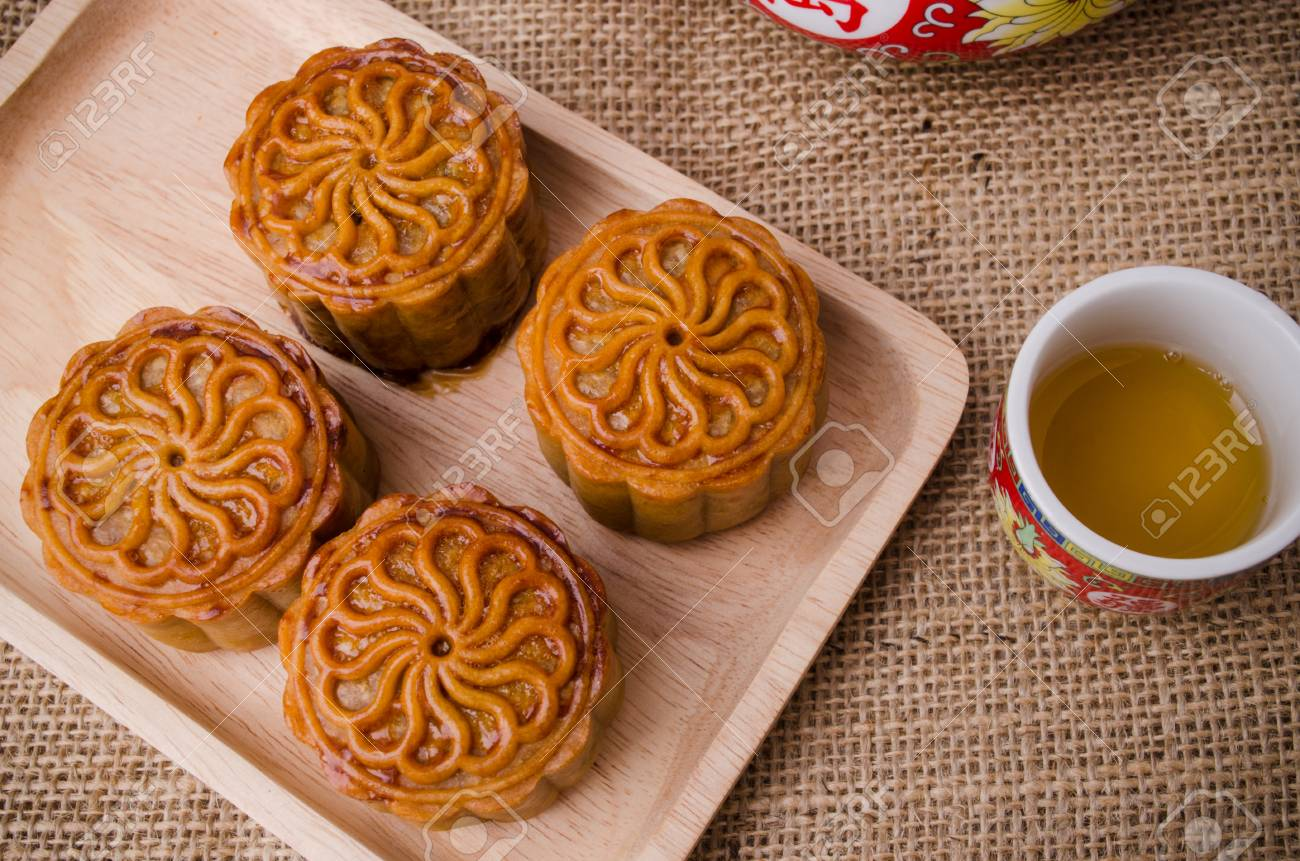 Chinese mid autumn festival foods. Traditional mooncakes on table setting with teapot. Stock Photo : traditional chinese table setting - Pezcame.Com