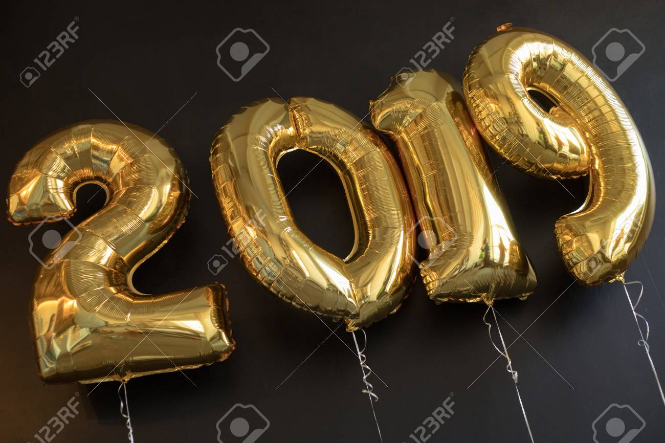 Sign 2019 Made Of Golden Balloons For New Year On Black Background