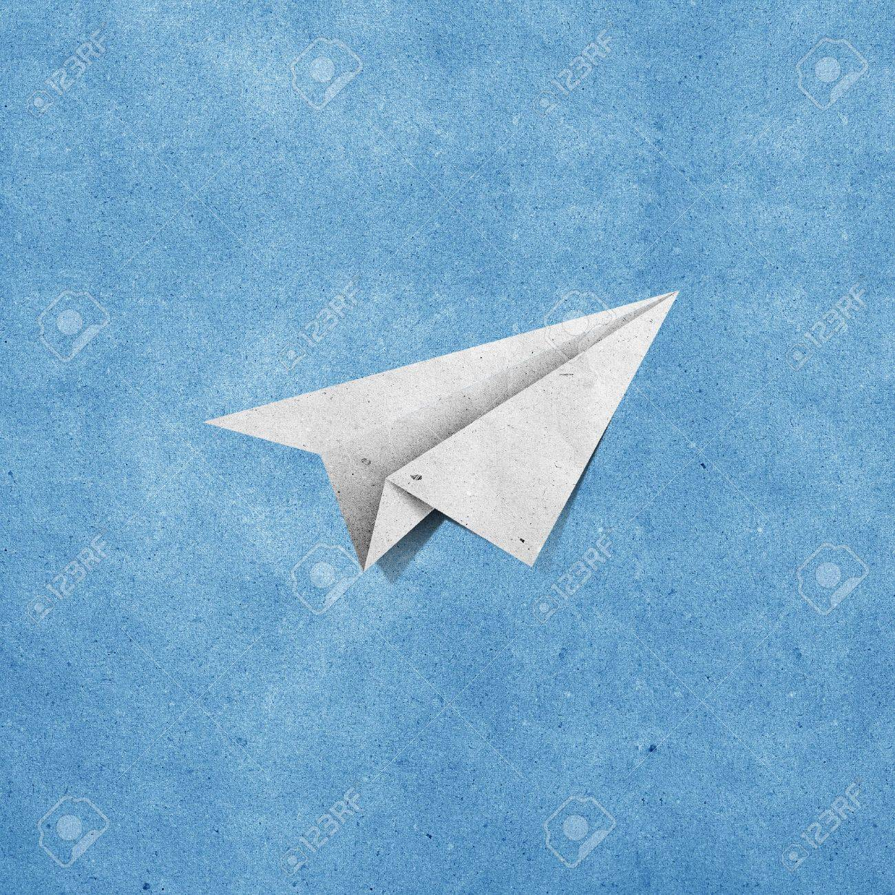 aircraft recycled paper on grunge blue sky paper background Stock Photo - 9971740