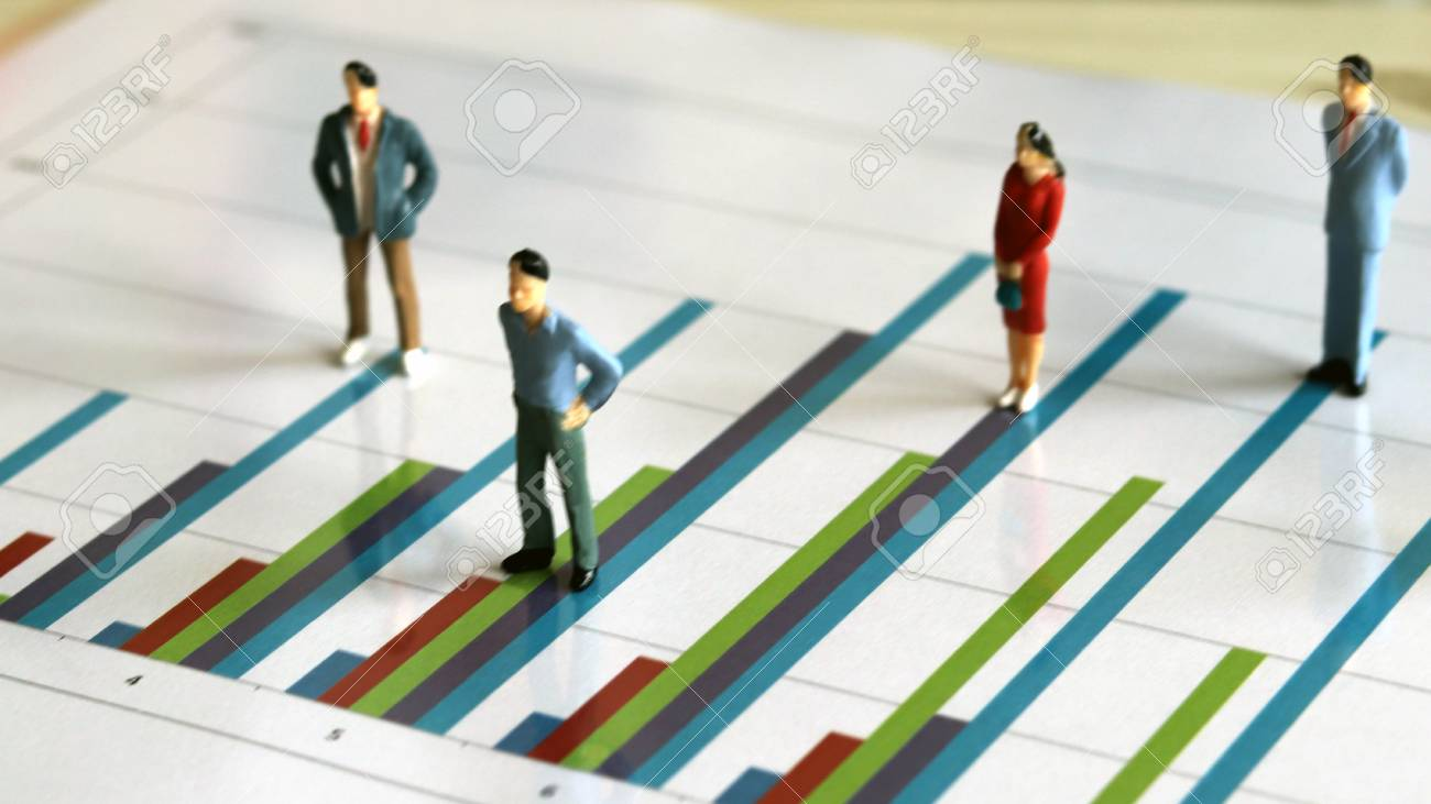 Miniature people and the graph concept. Miniature of men and woman on a bar graph. - 96194375