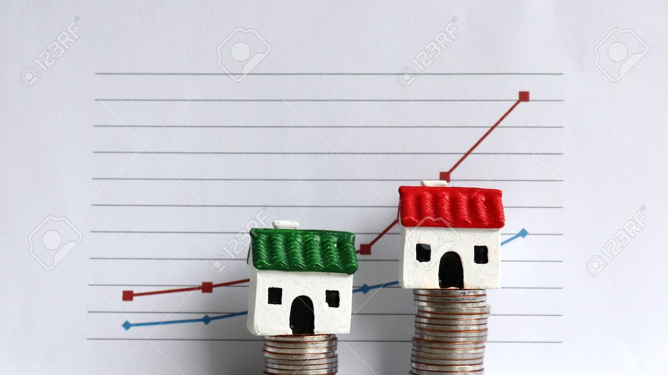 Housing price rising and differentiated concept. A miniature house on a pile of coins in front of a graph. - 99966249