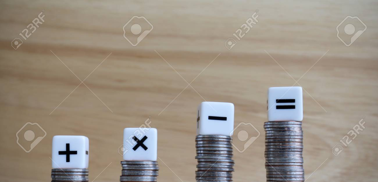The four arithmetic symbol cubes on top of the four coins. - 105516794