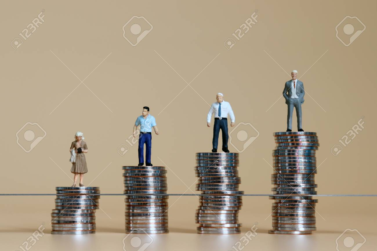 Miniature men and miniature woman standing on top of the piles of coins. - 106587789