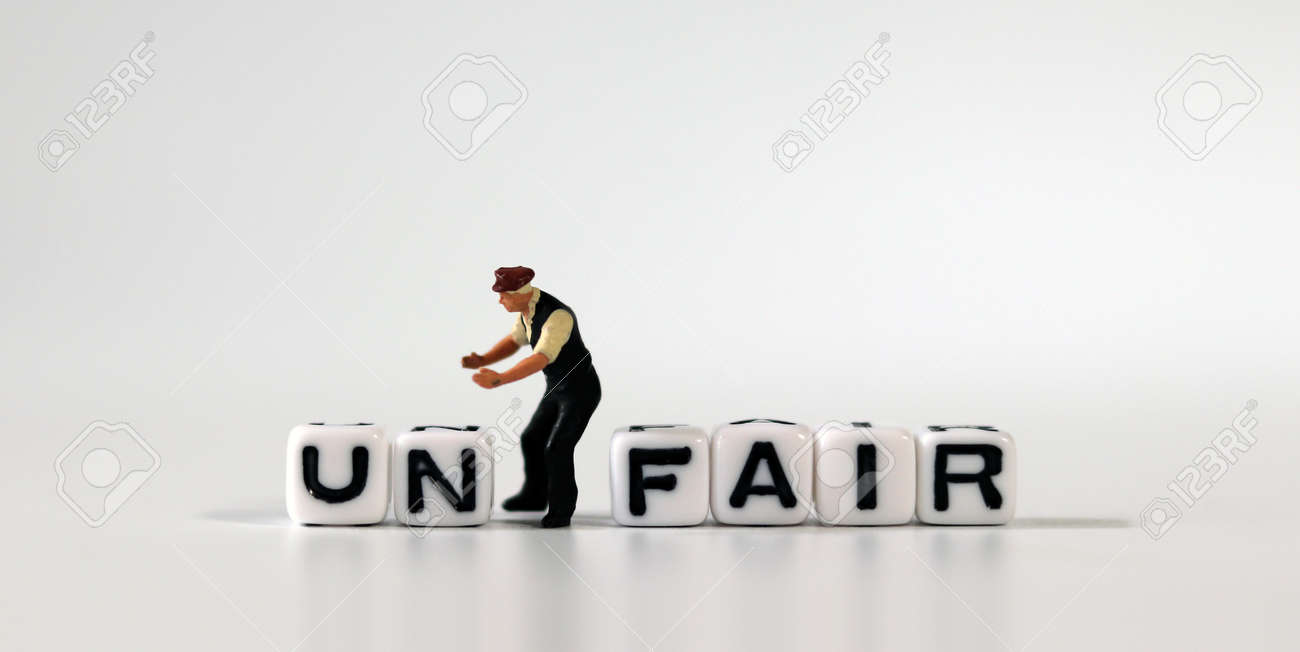 The word UN on white cubes and the word FAIR on white cubes. White cube with words and miniature people. - 167841724