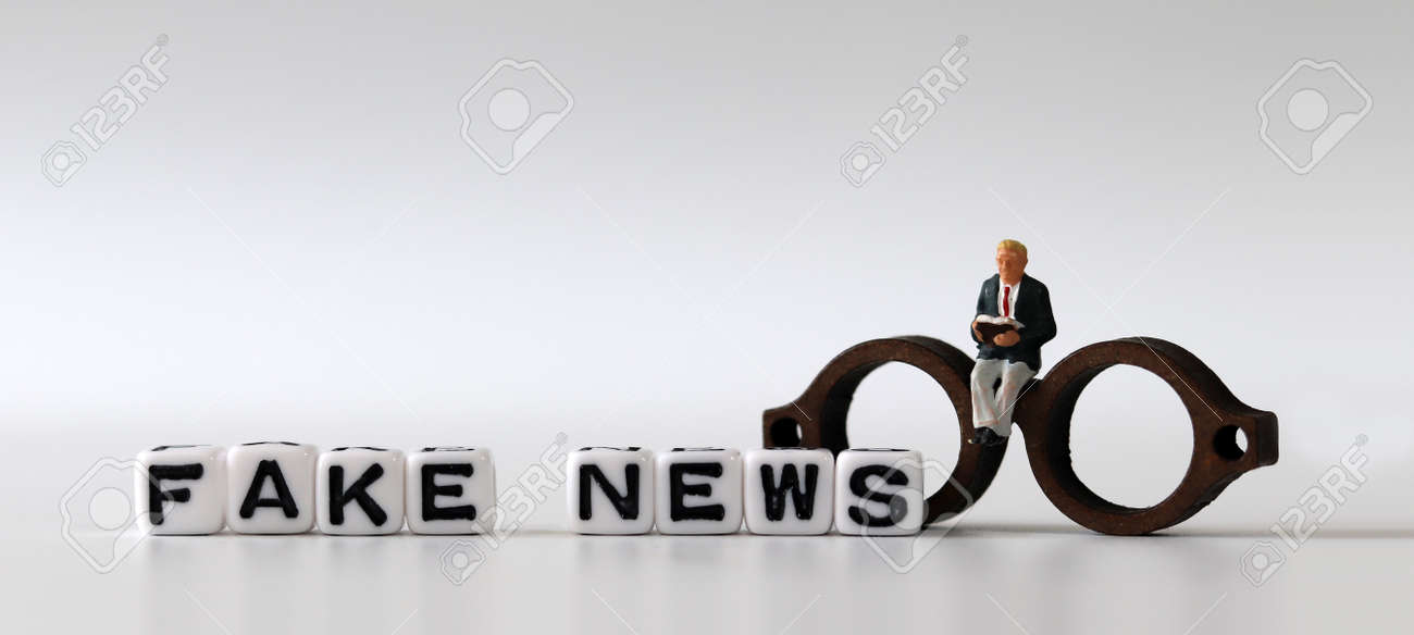 White dice and'FAKE NEWS' with News, solution and business concepts on white background. White cube and miniature people. - 169133305