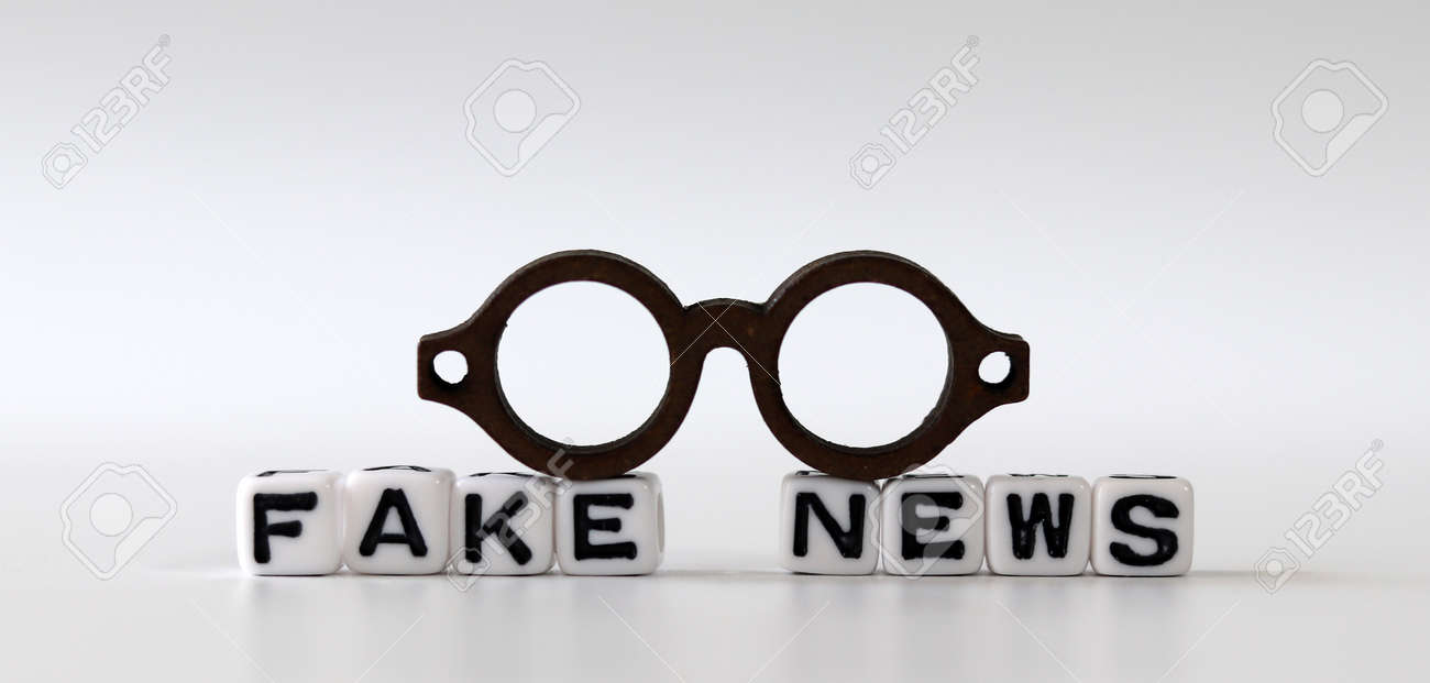White dice and'FAKE NEWS' with News, solution and business concepts on white background. White cube and miniature glasses. - 169133308