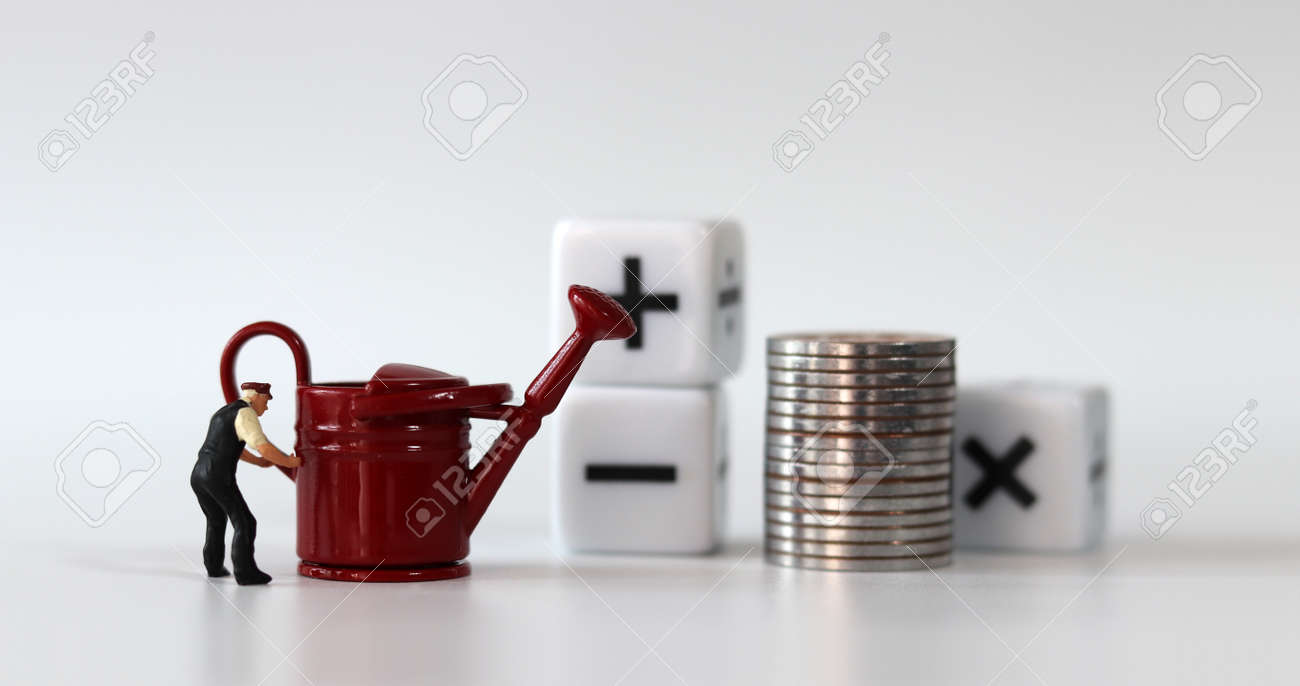 A watering can and a miniature man. A white cube with coins and arithmetic symbols. - 170214199