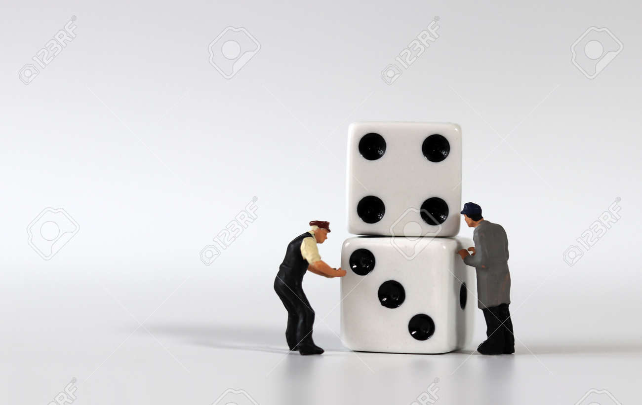 Two dice and two miniature men. Miniature people and business concept. - 170214200