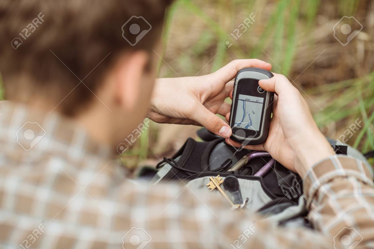 young tourist  in the woods determines location using gps Standard-Bild - 42659034