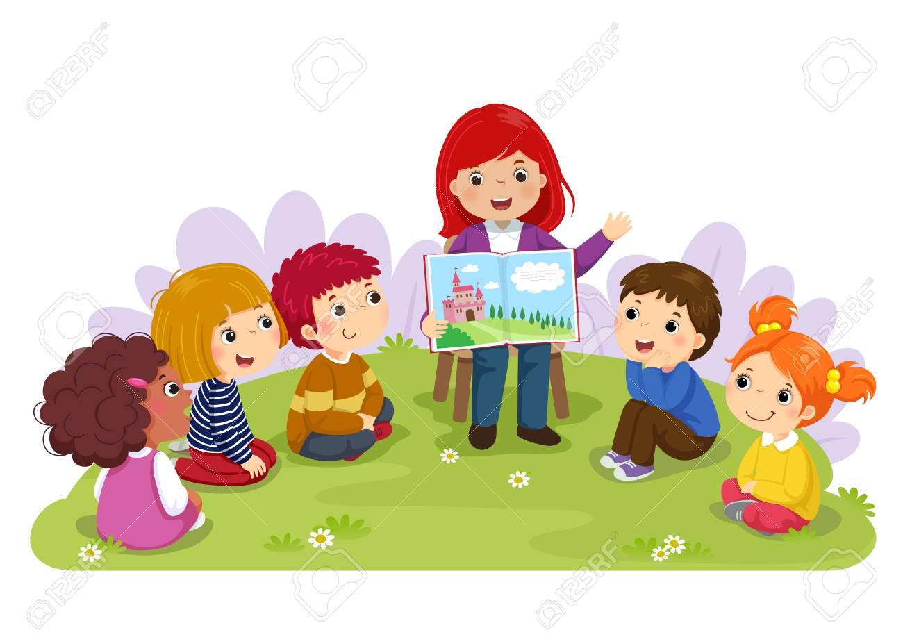 Teacher telling a story to nursery children in the garden - 93876714