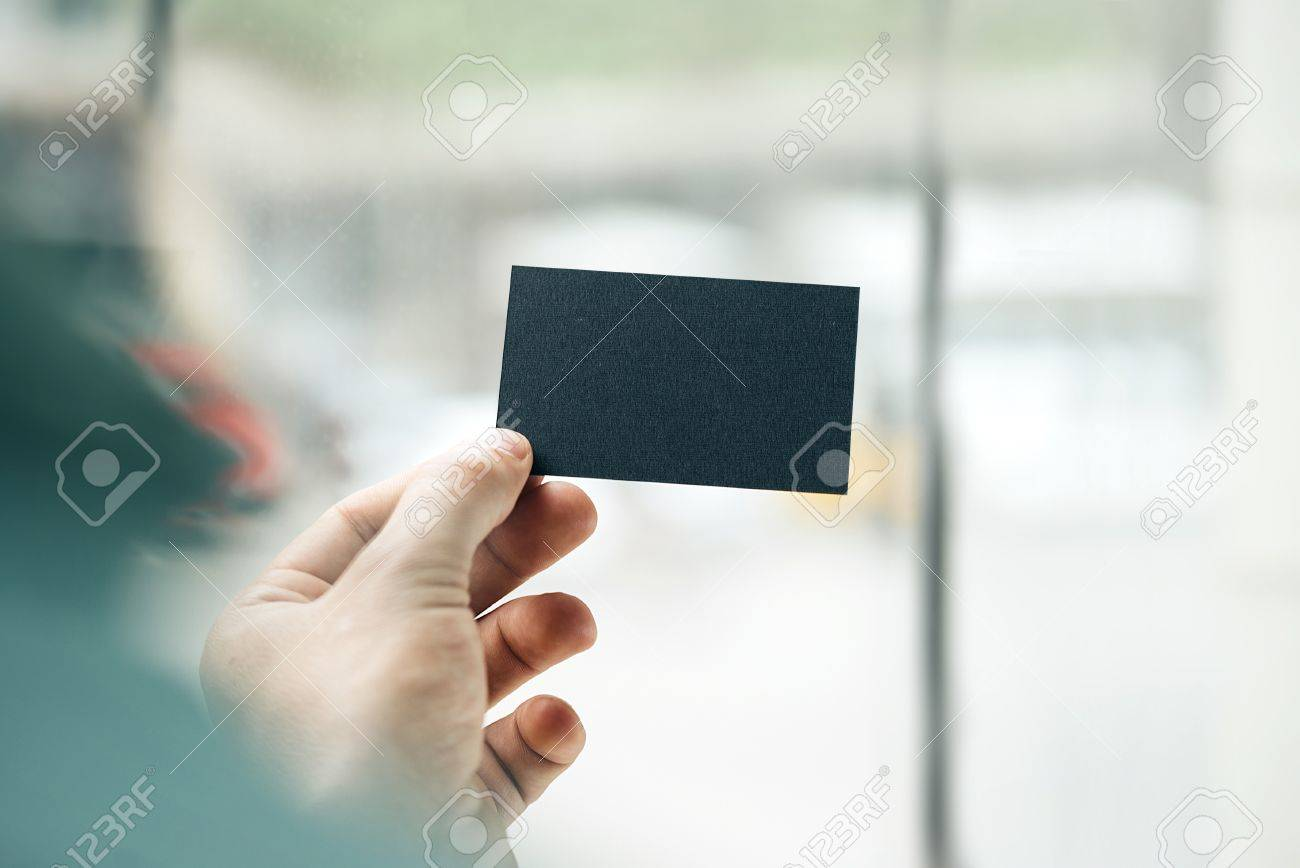 Hand Holding Business Card On Blurred Background Stock Photo ...