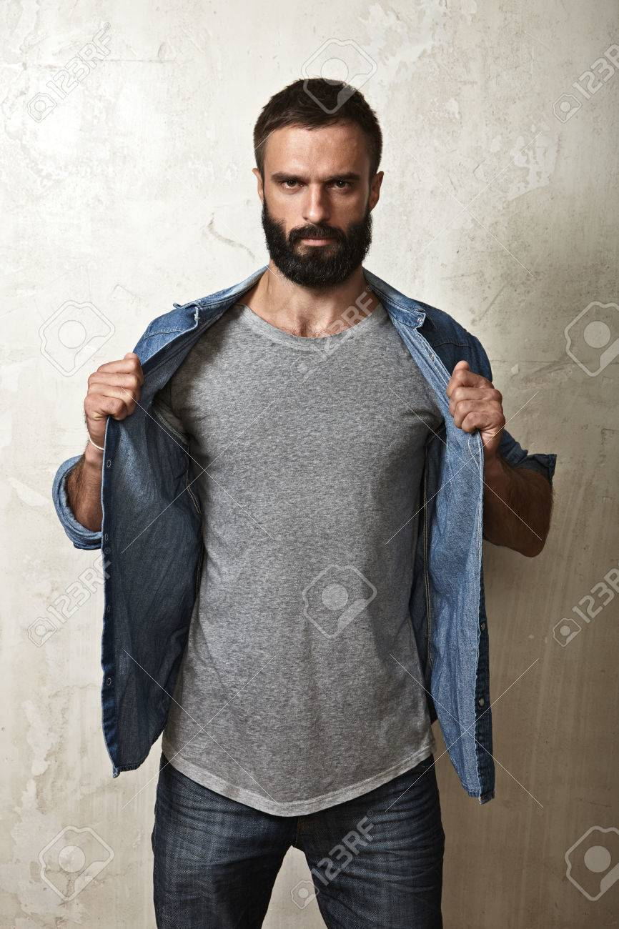 Black t shirt guy - Black T Shirt Model Portrait Of A Bearded Guy Wearing Blank T Shirt Stock